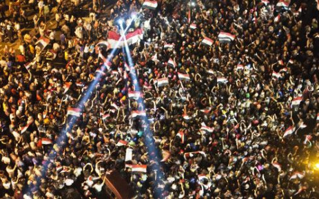 Egyptian demonstrators gather outside the presidential palace in Cairo during a protest calling for the ouster of President Mohamed Morsi on July 1, 2013. AFP PHOTO / KHALED DESOUKI.