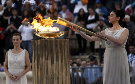Actress Ino Menegaki lights the Olympic Torch in Athens. Picture: AFP