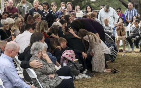Relatives and friends mourn during the funeral service of Dawna Ray Langford, 43, and her sons Trevor and Rogan, who were among nine victims killed on Monday in a hail of bullets in a attack authorities have blamed on a drug cartel. Picture: AFP