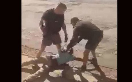 A video screengrab shows the two white men attacking the black man allegedly while trying to arrest him.