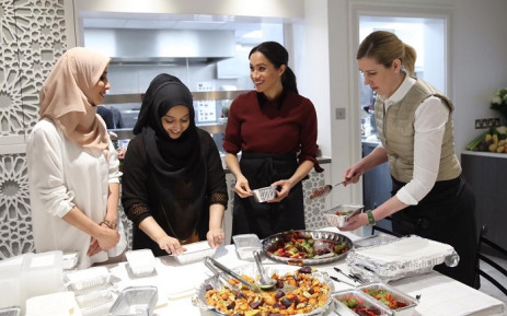 The Duchess of Sussex, Meghna Markle, introduces friend and Michelin starred chef Clare Smyth to the women of the Hubb Community Kitchen as they prepare 300 meals for the local community to be delivered to care homes, homeless shelters and women's refuges. Picture: @KensingtonRoyal/Twitter