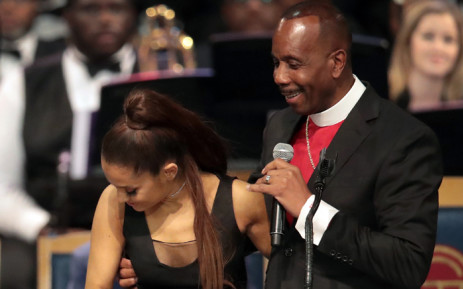 FILE: In this file photo taken on 31 August 2018 Bishop Charles Ellis chats with Ariana Grande after her performance at the funeral for Aretha Franklin at the Greater Grace Temple in Detroit, Michigan. Picture: AFP.