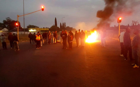 FILE: A road was barricaded with burning tyres in Lenasia South as residents protested over illegal land occupation. Picture: Mia Lindeque/EWN
