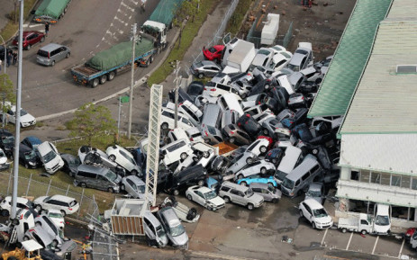An aerial view from a Jiji Press helicopter shows vehicles piled in a heap due to strong winds in Kobe, Hyogo prefecture on 5 September, 2018, after typhoon Jebi hit the west coast of Japan. Picture: AFP.