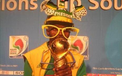 Fanatical Bafana Bafana supporter Saddam Maake clutches the FIFA Confederations Cup trophy. Picture: Lelo Mzaca/Eyewitness News