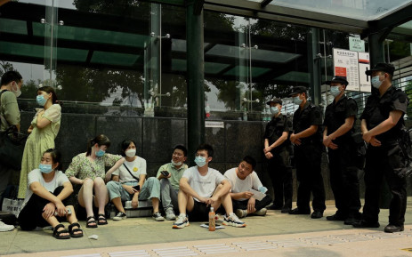 People gather at the Evergrande headquarters building in Shenzhen, southeastern China on September 15, 2021. Picture: Noel Celis / AFP.