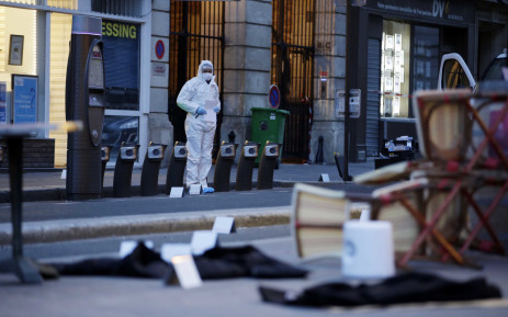 A forensic scientist inspects outside of the Cafe Bonne Biere on Rue du Faubourg du Temple in Paris on November 14, 2015, following a series of coordinated attacks in and around Paris late Friday, which left more than 120 people dead. Picture: AFP.