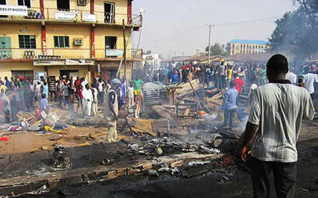 FILE: Nigerians survey the scene of a bomb blast in the northern city of Kaduna, Nigeria 23 July 2014. Picture:EPA.