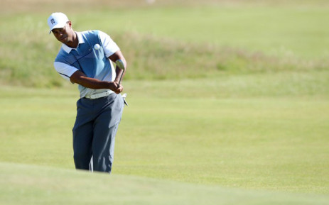 US golfer Tiger Woods chips onto the 5th green during his first round on the opening day of the 2014 British Open Golf Championship at Royal Liverpool Golf Course in Hoylake, north west England on July 17, 2014. Picture: AFP.