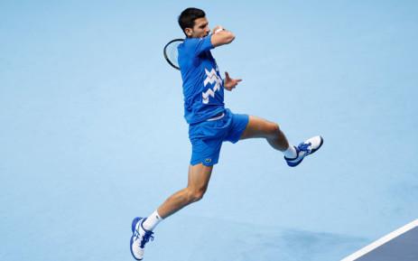 Novak Djokovic puts some effort into a return at the ATP Finals. Picture: @atptour/Twitter