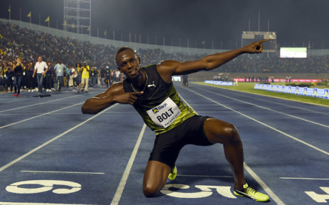 """FILE: Usain Bolt of Jamaica celebrates after winning 100m """"Salute to a Legend"""" race during the Racers Grand Prix at the national stadium in Kingston, Jamaica, on 10 June 2017. Picture: AFP"""