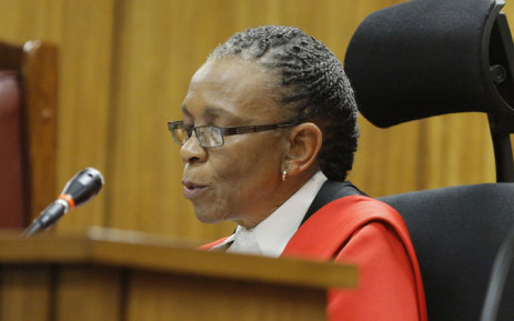 Judge Thokozile Masipa reads her judgment in the murder trial of Oscar Pistorius in Pretoria on 11 September 2014. Picture: Pool.