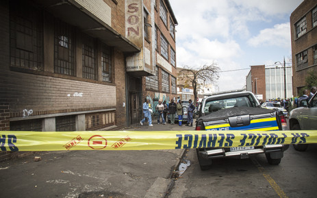 FILE: Forensic pathologists load the bodies of two South African males that were shot dead in a hostel in Jeppestown on 18 April 2015. Picture: Thomas Holder/EWN.