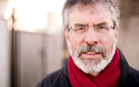 Sinn Fein President Gerry Adams poses while campaigning in Dundalk, County Louth, ahead of Ireland's General Election, 23 February 2011. Picture: AFP.