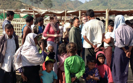 A UN assessment team talks to displaced people in Pauktaw camp in rural Rakhine, Myanmar, where more than 20,000 Rohingya live. Picture: United Nations.