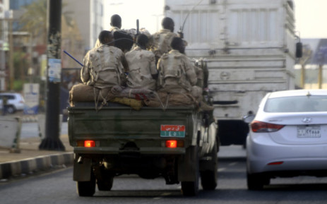Sudanese security forces ride in the back of a pick up truck through a main avenue in Khartoum as the military continued to disperse protesters by force in Sudan's capital on 4 June 2019.  Picture: AFP