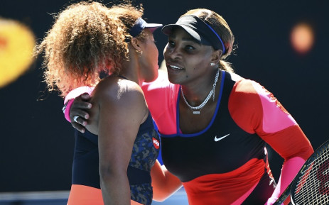 Japan's Naomi Osaka (L) gives a hug to Serena Williams of the US after their women's singles semi-final match on day eleven of the Australian Open tennis tournament in Melbourne on February 18, 2021. Picture: William West / AFP.