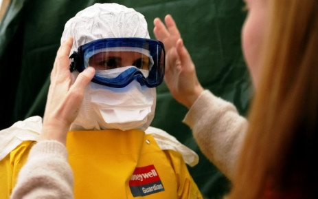 Health workers of the International Federation of Red Cross (IFRC) and Medical charity Medecins Sans Frontieres (MSF) take part in a pre-deployment training for staff heading to Ebola-affected countries, at the headquarters of the International Federation of Red Cross and Red Crescent Societies (IFRC), in Geneva, Switzerland, 4 November 2014. Picture: EPA.