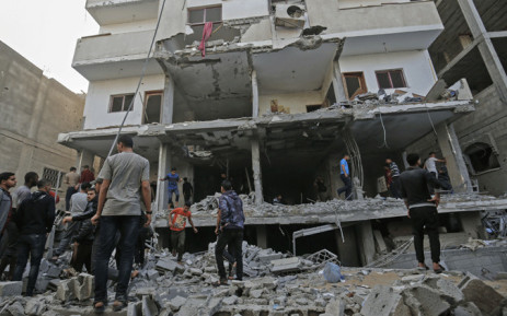 Palestinians check the damage in a building targeted by Israeli airstrikes on Rafah in the southern Gaza Strip on 5 May, 2019. Picture: AFP.