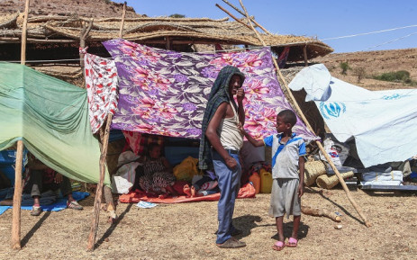 Ethiopian refugees who fled fighting in Tigray province stand outside a hut at the Um Rakuba camp in Sudan's eastern Gedaref province, on 16 November 2020. Picture: AFP.