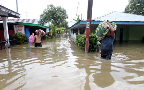 This picture taken on 27 April 2019 shows residents salvaging belongings as floodwaters submerged their homes after heavy rains in Bengkulu on the Indonesian island of Sumatra. Picture: AFP