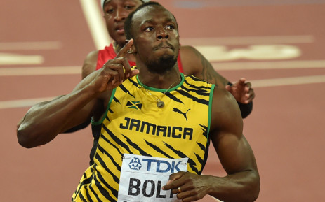 "Jamaica's Usain Bolt celebrates winning the final of the men's 100 metres athletics event at the 2015 IAAF World Championships at the ""Bird's Nest"" National Stadium in Beijing on 23 August, 2015. Picture: AFP."
