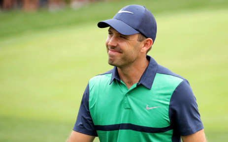 Charl Schwartzel smiles as he leaves the 18th green during the final round of the Valspar Championship at Innisbrook Resort Copperhead Course on 13 March, 2016 in Palm Harbor, Florida. Picture: AFP.