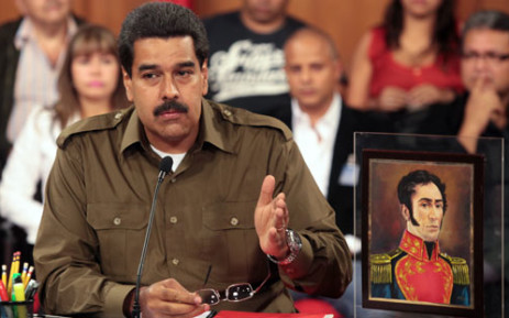 """""""This handout picture released by Venezuelan Presidency press office shows acting Venezuelan President Nicolas Maduro during an act at Miraflores presidential palace in Caracas on March 18, 2013. Picture: AFP."""
