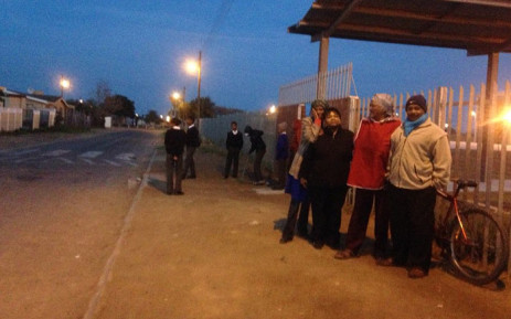 Strand parents gather outside the Rusthof Primary School following attempted abductions in the area. Picture: Shamiela Fisher/EWN.