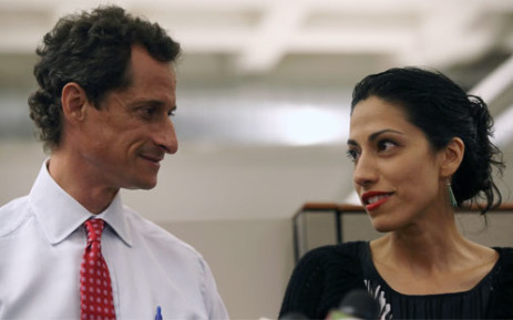 FILE: Huma Abedin (right) and with former husband Anthony Weiner at a press conference on July 23, 2013 in New York City. Picture: AFP.