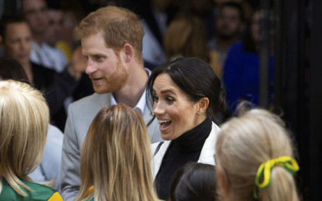 Britain's Prince Harry and his wife Meghan, Duchess of Sussex attend a lunchtime reception hosted by the Prime Minister with Invictus Games competitors and community representatives in the city's central parkland, The Domain, in Sydney on 21 October, 2018. Picture: AFP.