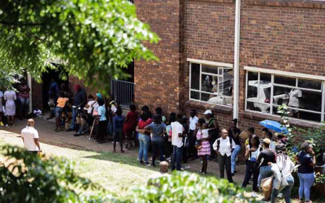 Parents and guardians queuing outside the Johannesburg Central Education District on 15 January 2020 where they are calling for the online application process to be scrapped in Gauteng. Picture: Kayleen Morgan/EWN