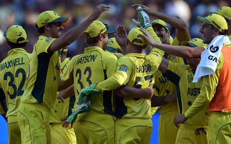 Australia's players congratulates wicketkeeper Brad Haddin (C) for his successful catch of New Zealand's batsman Ross Taylor Australia's paceman James Faulkner during the 2015 Cricket World Cup final between Australia and New Zealand in Melbourne on March 29, 2015. Picture:AFP