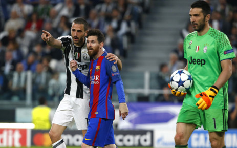 Juventus' defender from Italy Leonardo Bonucci speaks to Barcelona's Argentinian forward Lionel Messi next to Juventus' goalkeeper from Italy Gianluigi Buffon during the Uefa Champions League quarter final first leg football match Juventus vs Barcelona, on 11 April, 2017 at the Juventus stadium in Turin. Picture: AFP.