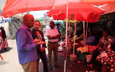 Nikiwe Bikitsha gets a guided tour of the Nairobi Flower Market. Picture: Primedia
