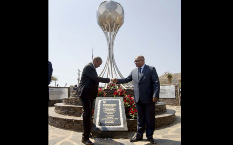 President Jacob Zuma and North West Premier Supra Mahumapelo stand before the Zuma Capture site monument unveiled in Groot Marico on 01 October 2017. Picture: GCIS.
