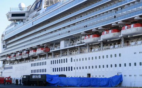 Japanese military personnel set up a covered walkway next to the 'Diamond Princess' cruise ship, with around 3,600 people quarantined onboard due to fears of the new coronavirus, at the Daikoku Pier Cruise Terminal in Yokohama port on 10 February 2020. Picture: AFP