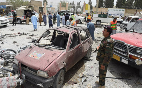 Pakistani security personnel gather at the site of a suicide attack near a polling station in Quetta on 25 July 2018. Picture: AFP.