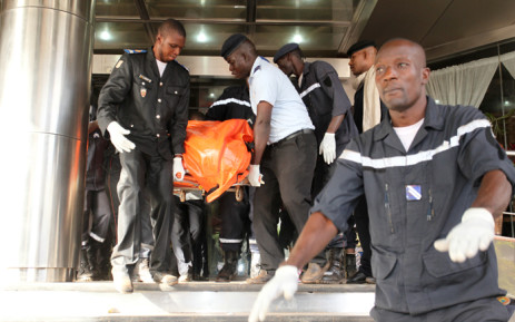 Officers evacuate bodies of victims from the Radisson Blu hotel in Bamako on November 20, 2015, after the assault of security forces. Malian forces backed by French troops stormed the Radisson Blu hotel in the capital Bamako after suspected Islamist gunmen seized guests and staff in a nine-hour hostage crisis that left at least 21 people dead. Picture: AFP.