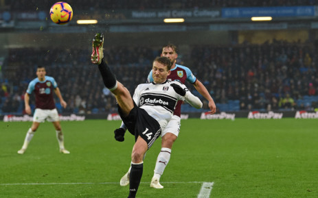 Fulham's German midfielder Andre Schurrle (C) clears the ball during the English Premier League football match between Burnley and Fulham at Turf Moor in Burnley, north west England on 12 January 2019. Picture: AFP