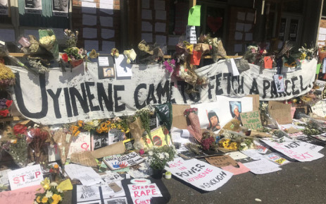 Flowers, posters and messages outside the post office in Claremont where Uyinene Mrwetyana was murdered. Picture: Lizell Persens/EWN