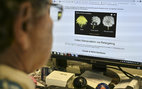 An AFP journalist views an example of a 'deepfake' video manipulated using artificial intelligence, by Carnegie Mellon University researchers, from his desk in Washington, DC 25 January 2019. Picture: AFP