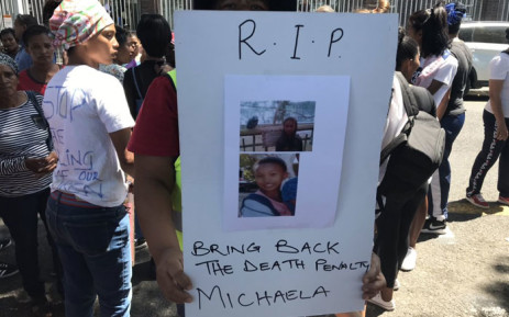 A community member holds a poster outside of court on 14 January 2020, calling for the return of the death penalty after Michaela Williams, 12, was raped and murdered by a repeat offender. Picture: Lauren Isaacs/EWN.