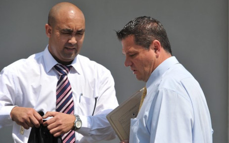 FILE: The National Prosecuting Authority's Shaun Abrahams (left) and General Zeeman, the investigating officer for the case against Henry Okah, outside the Johannesburg Magistrates court, on 4 October 2010. Picture: Gallo Images/Foto24/Felix Dlangamandla.