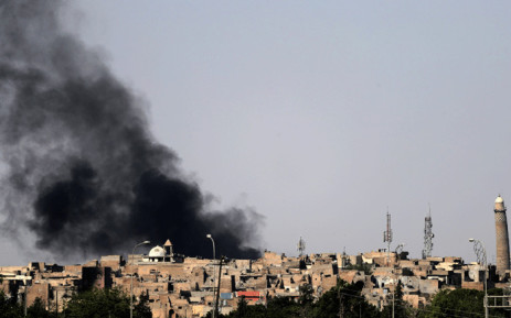 A general view shows smoke billowng near the historic leaning minaret of the Great Moaque of al-Nuri in the old city of Mosul. Picture: AFP.