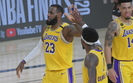 LeBron James (#23) of the Los Angeles Lakers high fives his teammate during the game against the Miami Heat during Game One of the NBA Finals on 30 September 2020 in Orlando, Florida at AdventHealth Arena. Picture: AFP