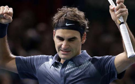 FILE: Federer, bidding to add to his substantial collection of honours by steering the Alpine nation to a first Davis Cup triumph, delighted a capacity crowd in the Palexpo Arena. Picture: AFP.