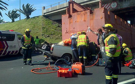 A motorist trapped in a bakkie on Lower Church Street following an accident on 15 October 2013. Picture: Zain Johnson/EWN