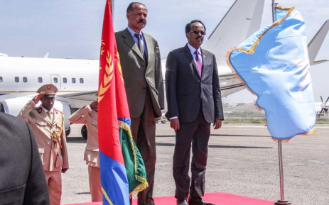 Eritrea's President Isaias Afwerki (L) and Somalia's President Mohamed Abdullahi Farmajo review the honour guard upon Afwerki's arrival at Aden Abdulle international airport in Mogadishu, on 13 December 2018. Picture: AFP
