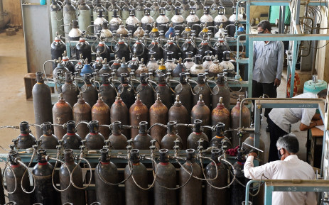 Technicians monitor medical oxygen refilling lines at a supply plant in Ahmedabad on 3 May 2021, as the demand for medical oxygen increased amid COVID-19 coronavirus pandemic. Picture: Sam Panthaky/AFP